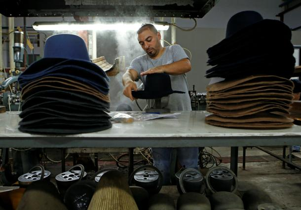 An employee works on a Borsalino hat in the factory in Alessandria c26a749306b9